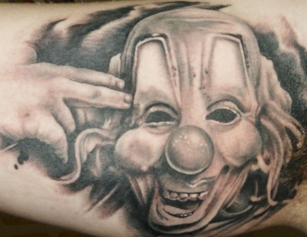 grey-ink-jester-clown-tattoo-on-inner-bicep